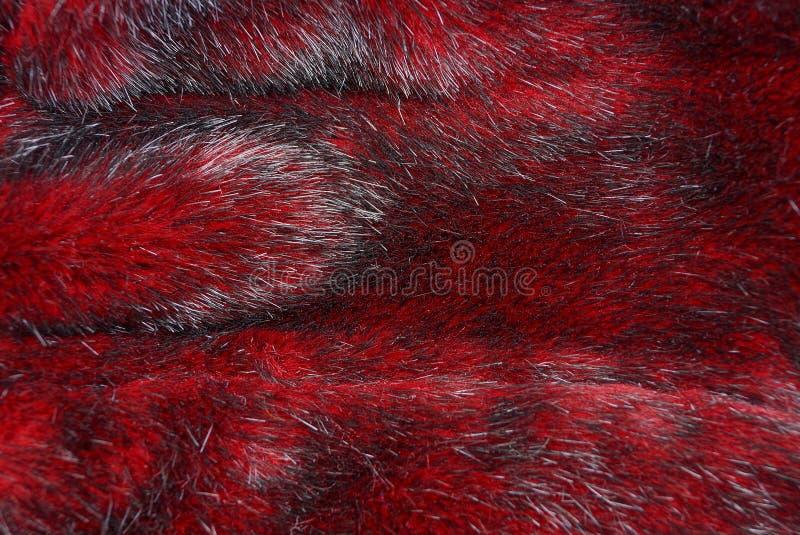 Tekstura czerwony futerko na kawałku odzież obraz stock