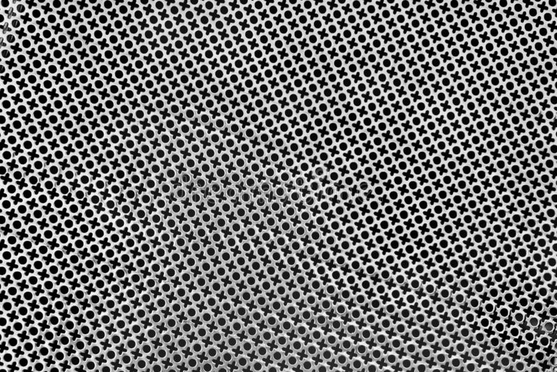 Tekstura dziurkowaty metalu prześcieradło stemplujący tworzyć XO wzór lub uderzający pięścią fotografia royalty free