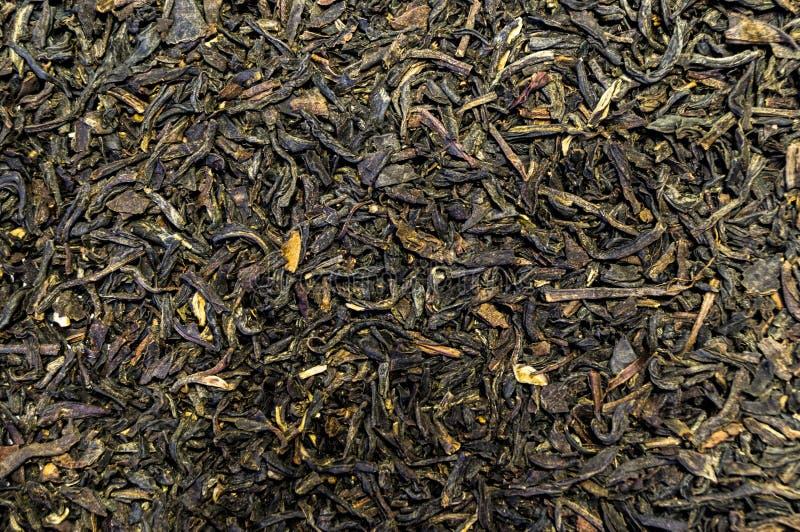 Tekstura herbata rozpraszał na stołowej powierzchni fotografia royalty free