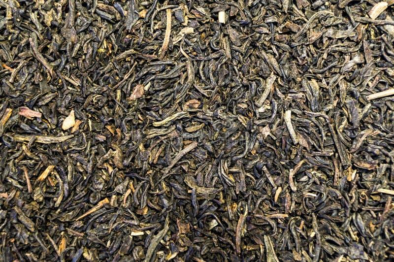 Tekstura herbata rozpraszał na stołowej powierzchni zdjęcie stock