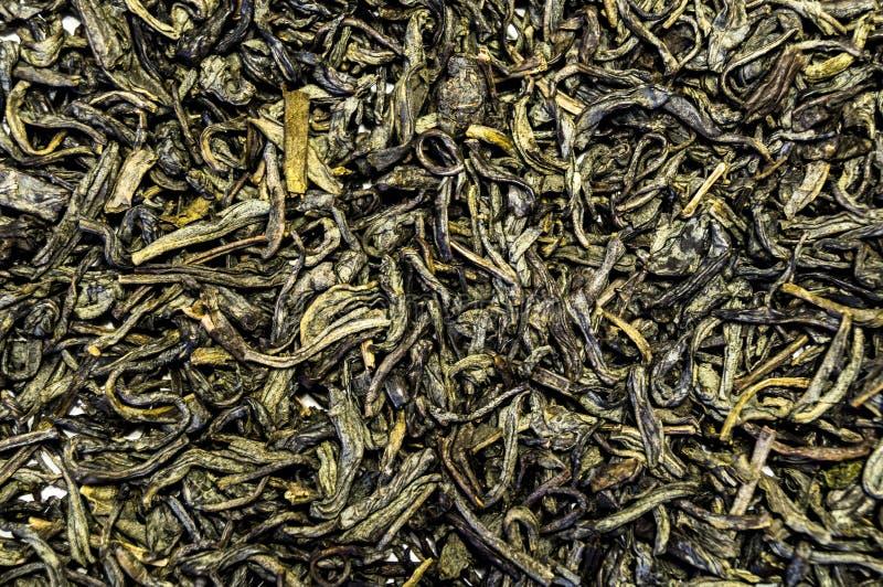 Tekstura herbata rozpraszał na stołowej powierzchni zdjęcia royalty free