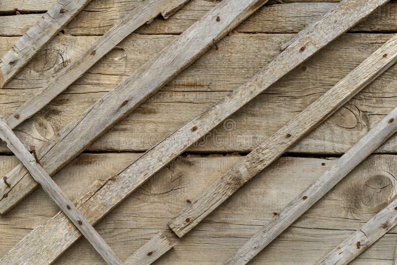 Tekstura i tło drewniana pokrywa z dużymi ośniedziałymi gwoździami stara i szara br?zowy t?a tekstury pomocniczym drewna Druk bro fotografia stock