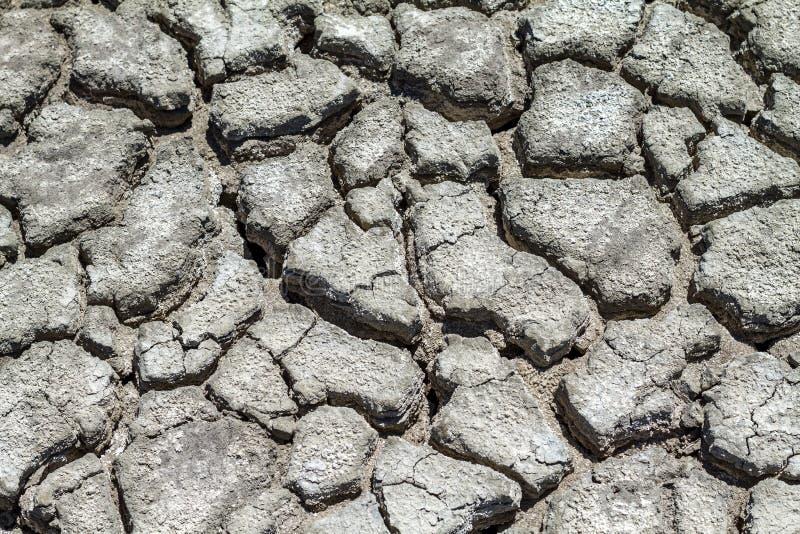 Tekstura krakingowa ziemia, kataklizm susza zdjęcia stock