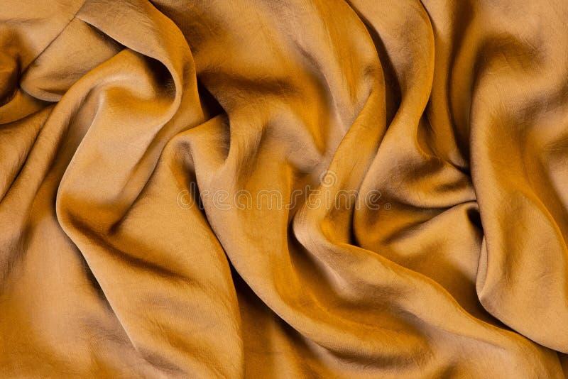 Tekstura miękki i błyszczący złoty jedwab obraz royalty free