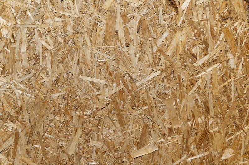 Tekstura naciskający drewniani golenia Chipboard szkotowy zbliżenie, tła puste miejsce Deskowy trociny pod obrazy stock