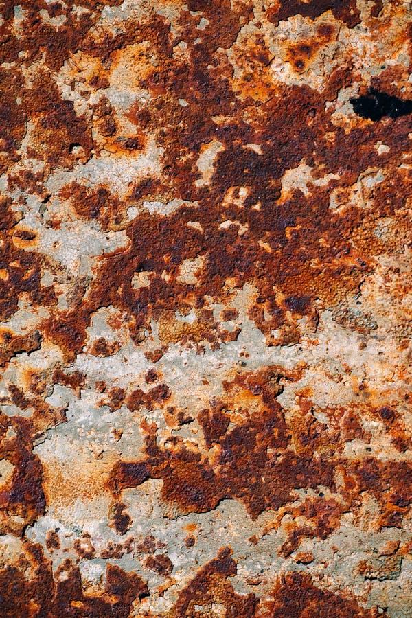 Tekstura ośniedziały żelazo, krakingowa farba na starej kruszcowej powierzchni, fotografia royalty free