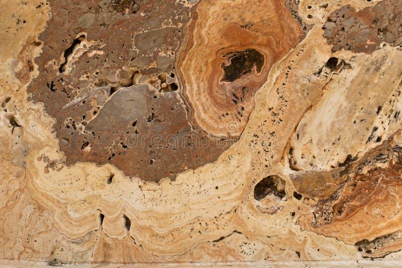 Tekstura Onyksowy agat skrzyknąca skała w brązie i beżowym kolorze z zdjęcia royalty free