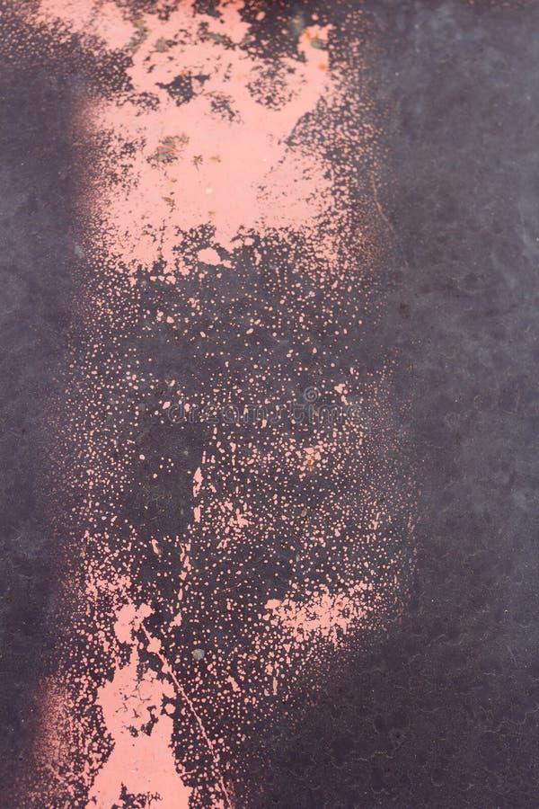 Tekstura rdzawego metalu malowana w kolorze czarnym i czerwonym zdjęcia royalty free