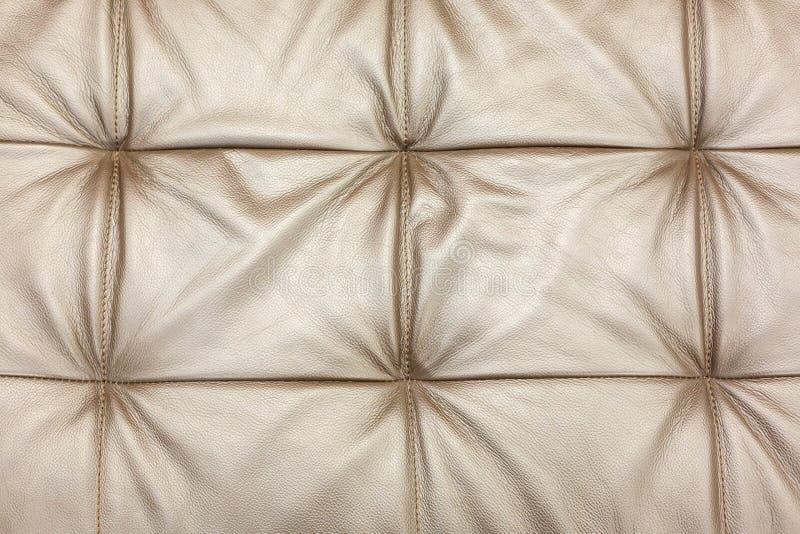 Tekstura rzemienny beżowy kanapy tapicerowanie jako tło obraz royalty free