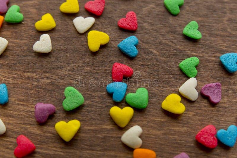 Tekstura słodkie kolorowe cukierek dekoracje w postaci serca zdjęcia stock