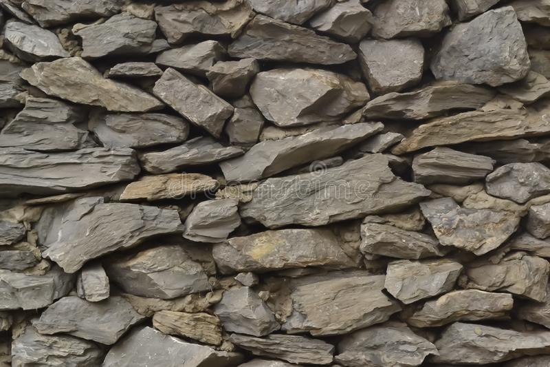 Tekstura szary kamiennej ściany ogrodzenie w ulicie zdjęcia royalty free