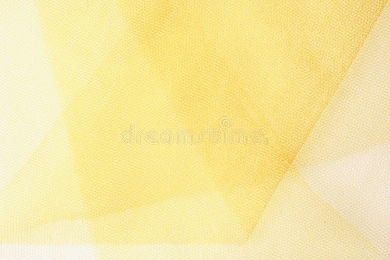 Tekstura, tło, wzór Żółta jedwabnicza tkanina Gładki elegancki fotografia royalty free