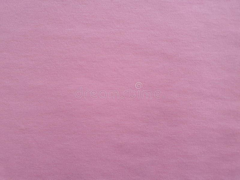 Tekstura, tło, wzór, brzoskwinia koloru miękka bawełniana tkanina Ten pościel może być używać werteks, DIY projekty, wystrój zdjęcie royalty free