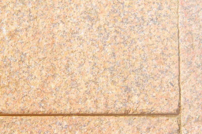 Tekstura, tło, wzór Curbstone jest czerwony Granitowy arra obrazy stock