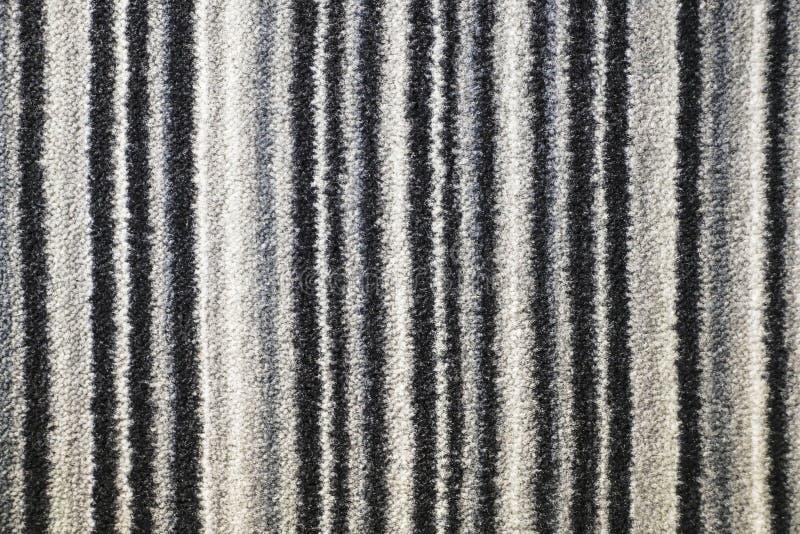 Tekstura tekstylny dywanik z pasiastym wzorem biały, szarość i b, zdjęcia stock