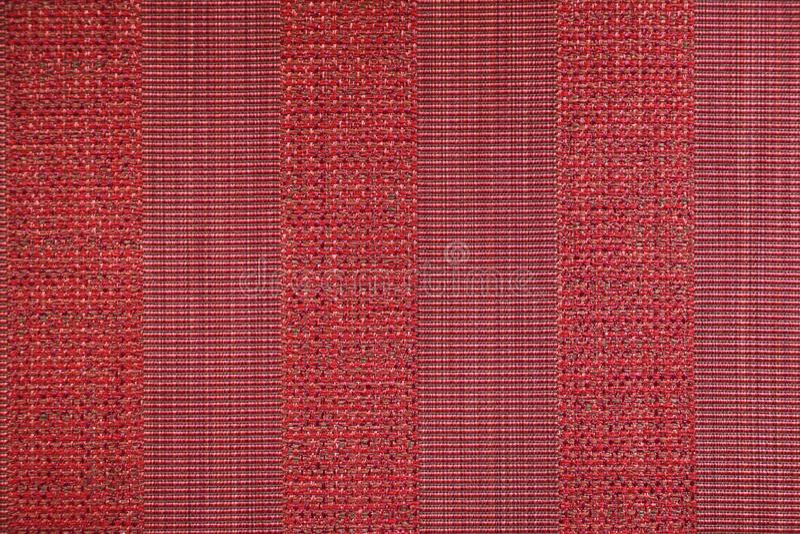 Tekstura tekstylny dywanik z pasiastym wzorem czerwoni kolory fotografia royalty free