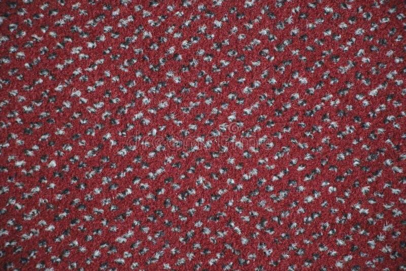 Tekstura tekstylny dywanik z wzorem czerwieni, białego i czarnego colo, obrazy royalty free