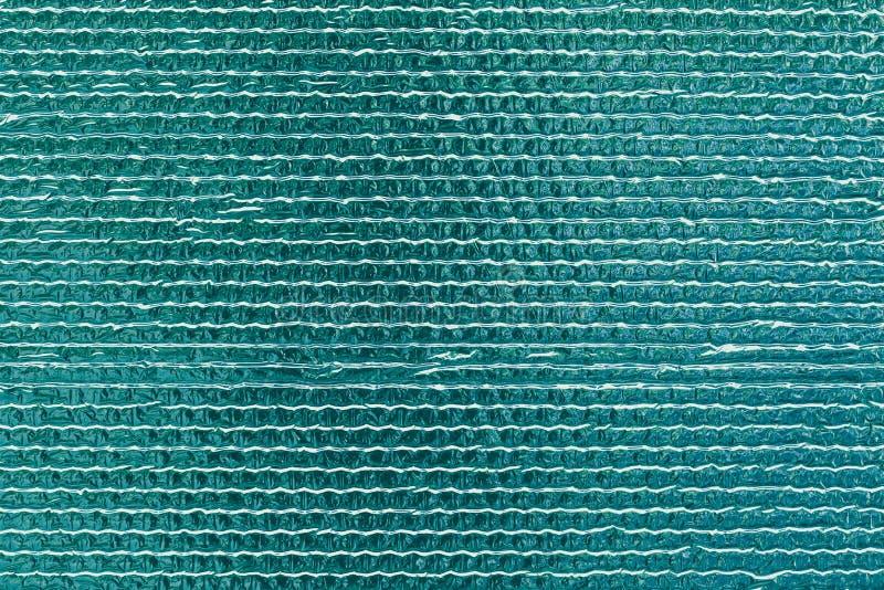 Tekstura turkusowa odbijająca błyszcząca ściana Olśniewający zieleni folii tło Abstrakcjonistyczny błyskotliwość wzór Odbijający  zdjęcia stock