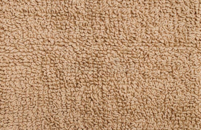 Tekstura wełnisty dywan beżowy kolor zdjęcia stock