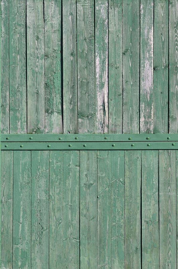Tekstura wietrzejąca drewniana ściana Starzejący się drewniany deski ogrodzenie pionowo mieszkanie deska obrazy royalty free