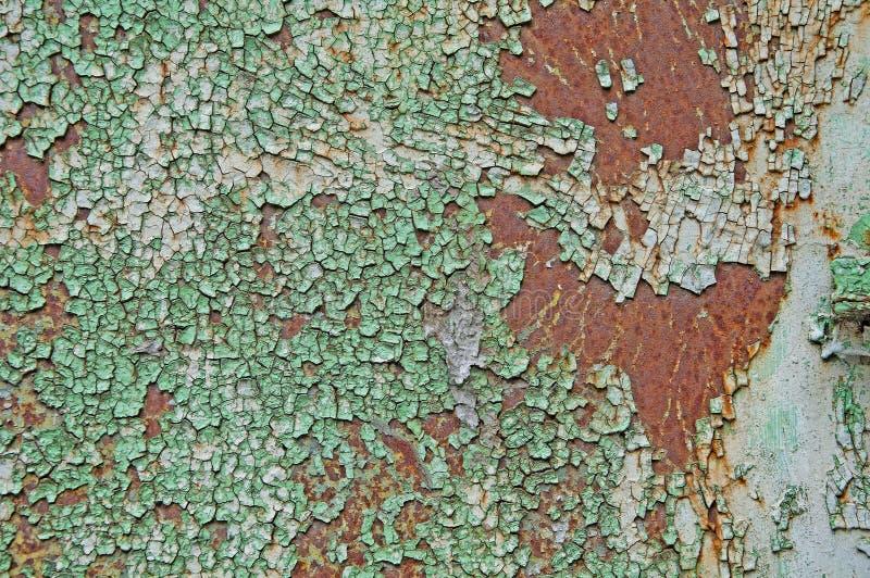 Tekstury i tło stary szkotowy metal Strugać farbę na zielonego i białego metalu prześcieradła tle zdjęcie royalty free