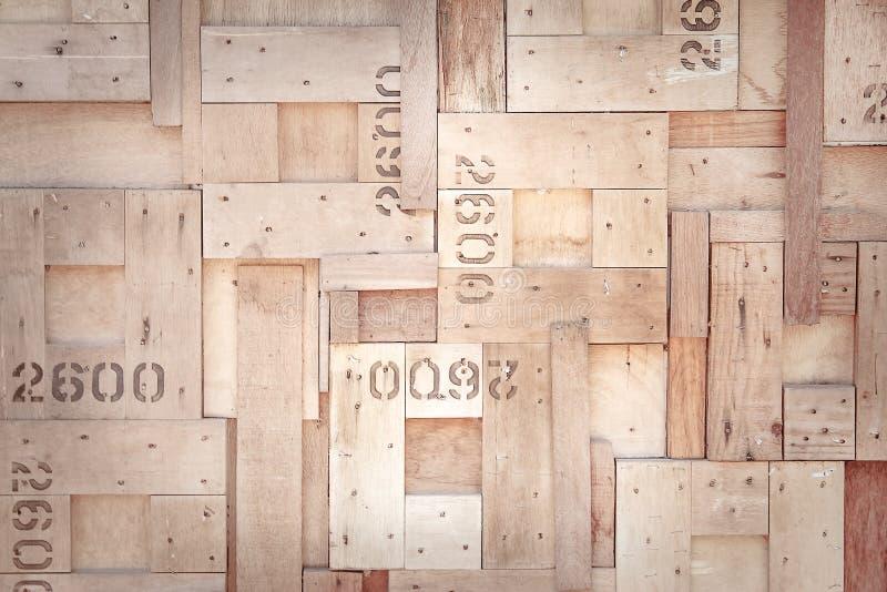 Tekstury nasunięcia dekoracyjna natura stary brązu drewno w kwadratów wzorach z liczbą na ściennym tle, dwa, sześć i zero, zdjęcie royalty free