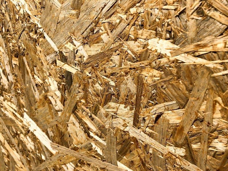 Tekstury od kąta drewniany żółty materiał budowlany od goleń OSB i ściśniętego trociny, meblarski produkcja odpady obrazy stock