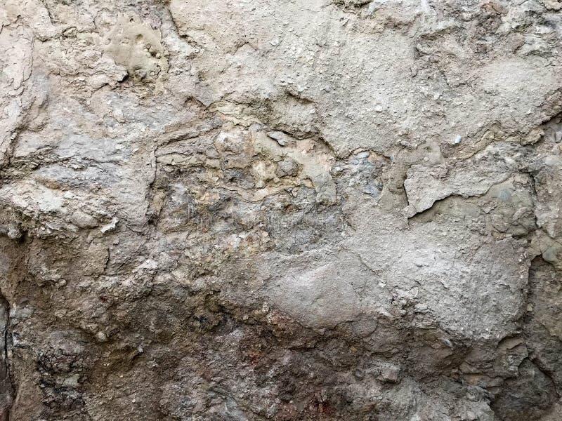 Tekstury szarość ablegrująca piękna naturalna textured kopalina rzeźbiąca z pęknięciami i burzliwością stary suchy obieranie kami obraz stock