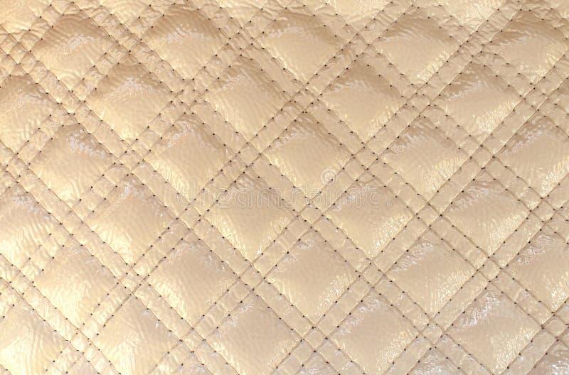 Tekstury sztucznej skóry koloru z kości słoniowej diament z zaszytym ściegiem zdjęcia stock