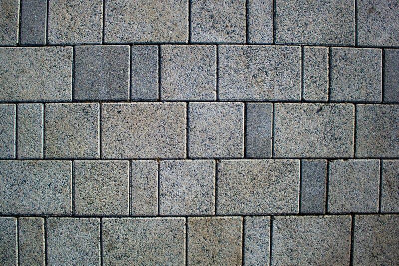 Tekstury tła brukowy kamień, wielki cegiełka bruk, zwyczajna ulica fotografia royalty free