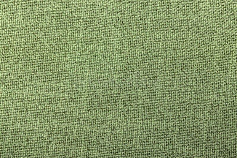 Tekstylnego zielonego koloru szorstkiego tkactwa niciana tekstura w górę fotografia royalty free