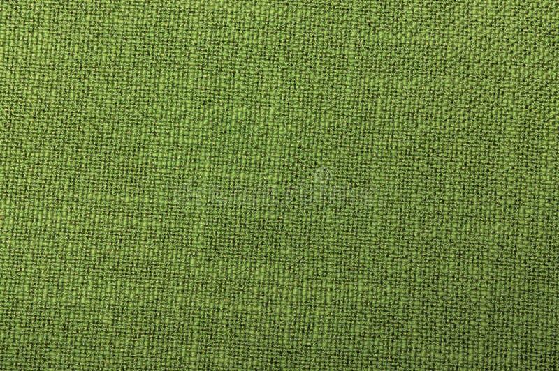 Tekstylnego zielonego koloru szorstkiego tkactwa niciana tekstura w górę fotografia stock