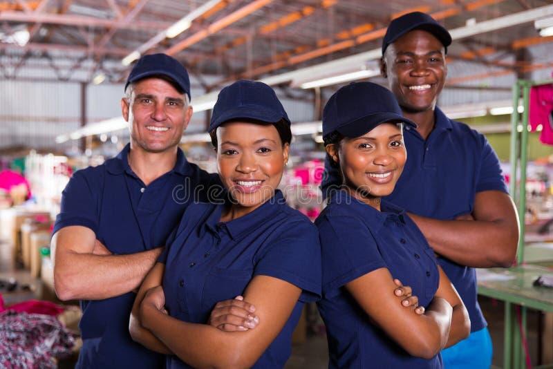 Tekstylni fabryczni pracownicy obrazy stock
