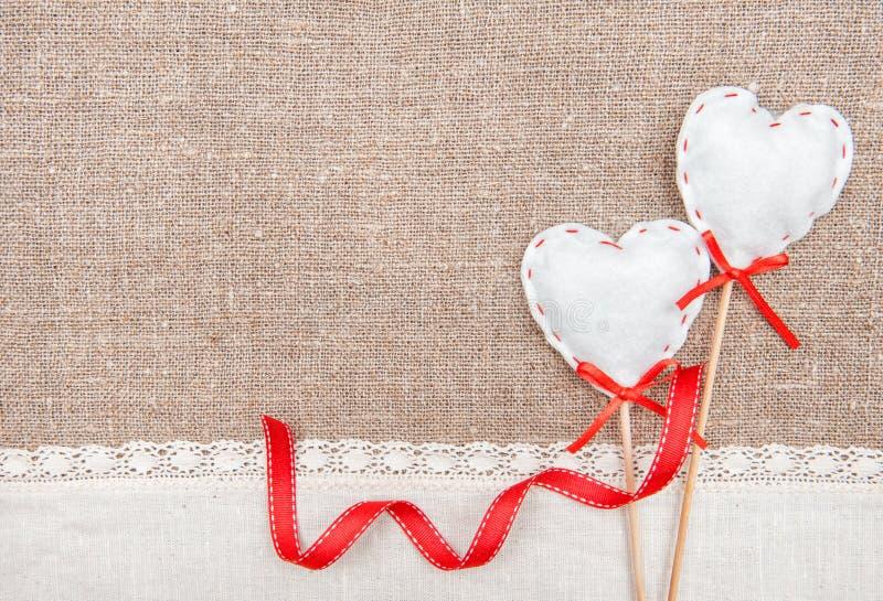 Tekstylni serca, faborek i bieliźniany płótno na burlap, zdjęcie royalty free