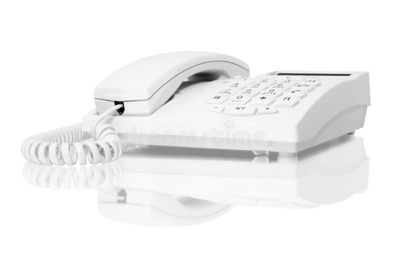 Teléfono blanco foto de archivo