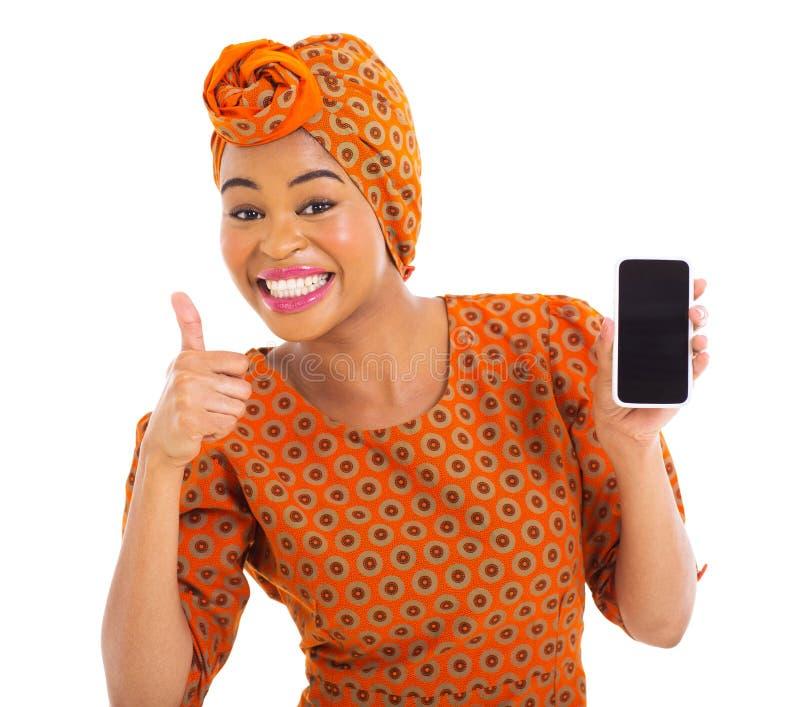 Teléfono celular africano de la muchacha imagenes de archivo