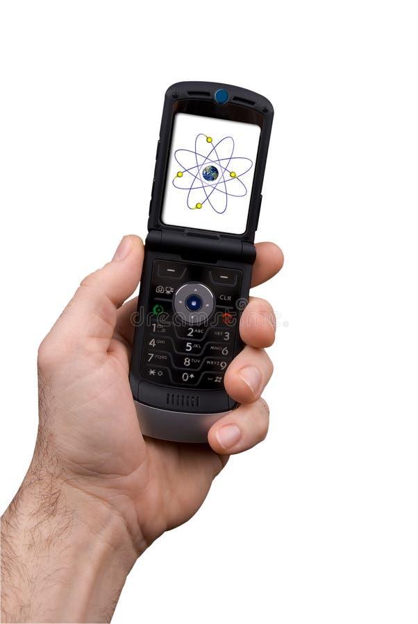 Teléfono celular de explotación agrícola del hombre con el núcleo fotos de archivo libres de regalías