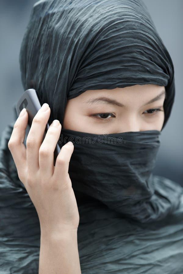 Teléfono celular hablando fotos de archivo