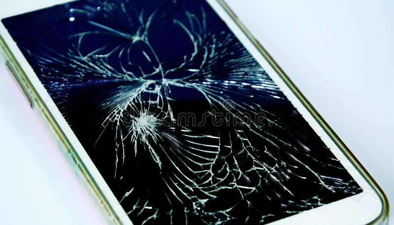 Teléfono celular quebrado de la pantalla táctil foto de archivo