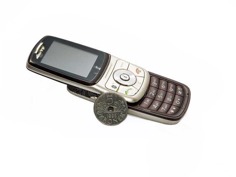 Teléfono celular viejo y moneda noruega fotos de archivo libres de regalías