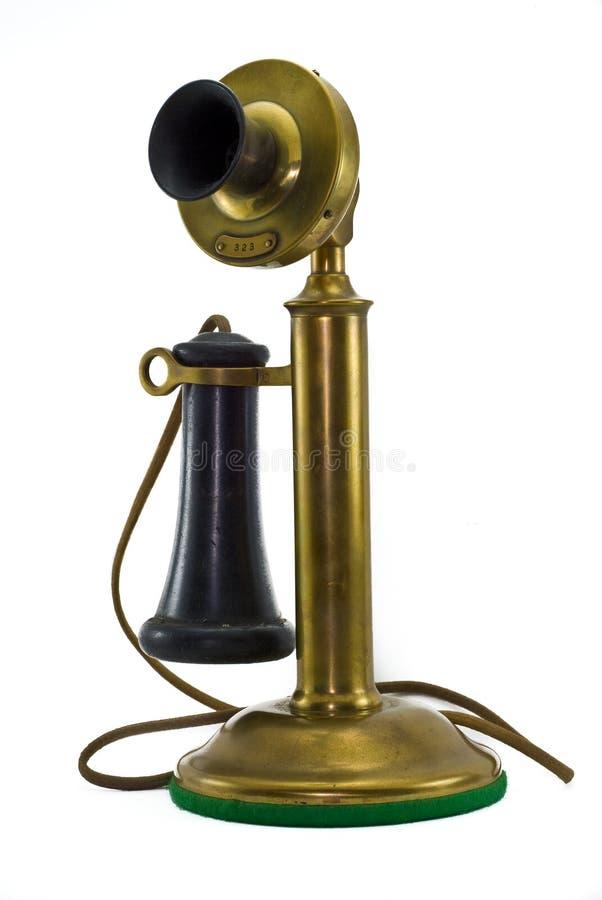 Teléfono de cobre amarillo antiguo imágenes de archivo libres de regalías