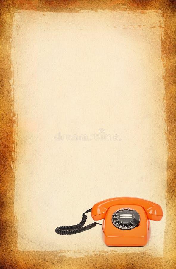 Teléfono de la baquelita sobre fondo manchado imagen de archivo