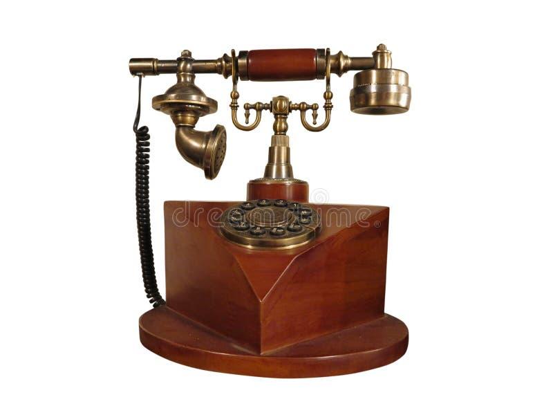 Teléfono de madera del viejo estilo del vintage con el dial retro del disco aislado imagen de archivo