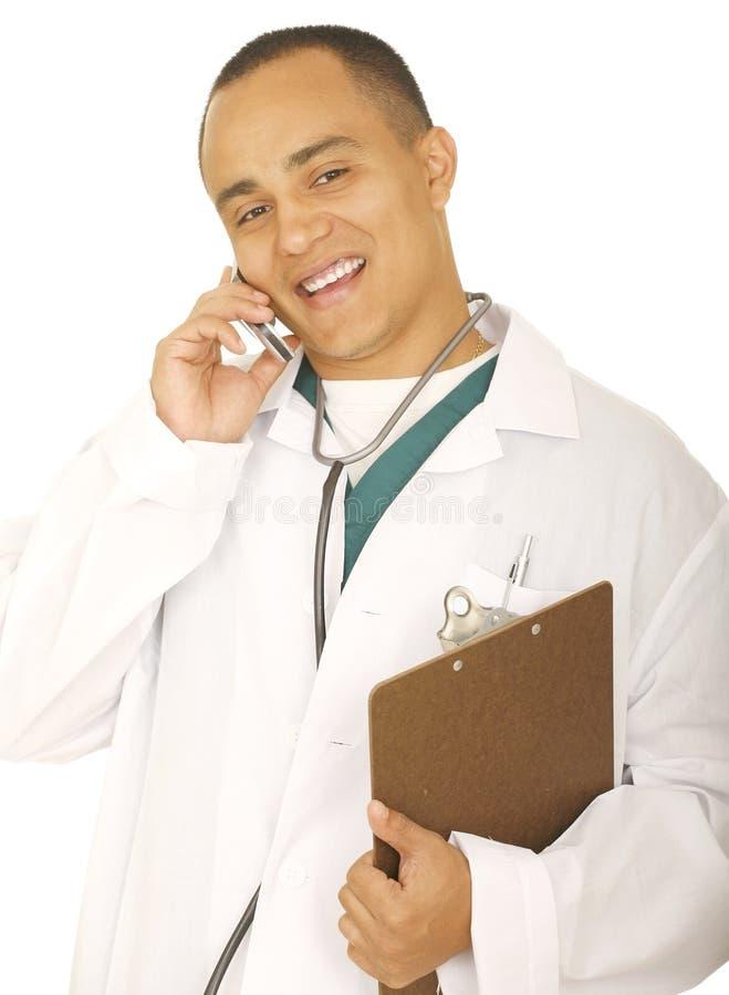 Teléfono del doctor Man Laughing On The imagen de archivo libre de regalías