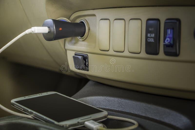 Teléfono del enchufe del cargador foto de archivo