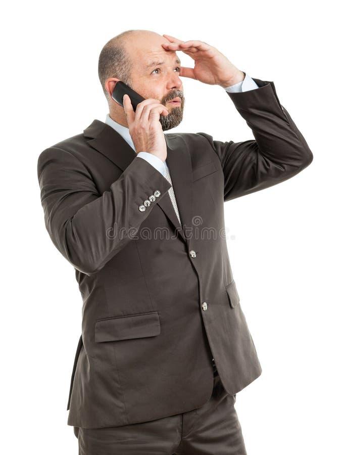 Teléfono del hombre de negocios foto de archivo