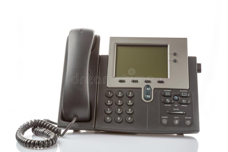 Teléfono digital moderno del IP aislado en el fondo blanco con la reflexión Concepto de la solución de la voz del IP de la empres imagen de archivo