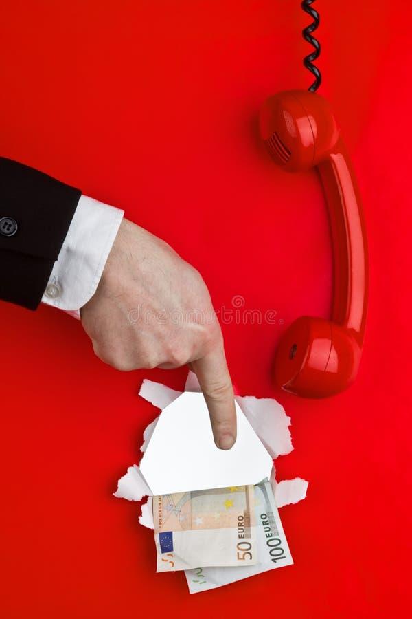 Teléfono, dinero y mano fotografía de archivo