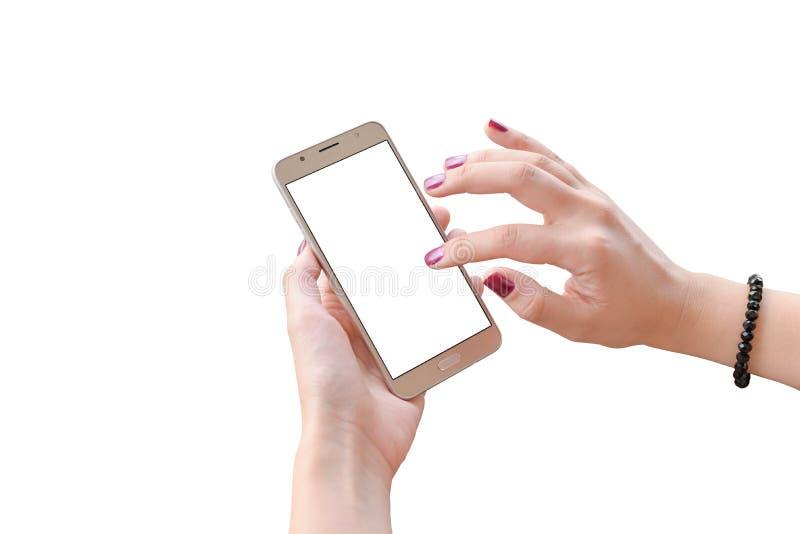 Teléfono elegante aislado en manos de la mujer Pantalla del teléfono móvil del tacto de la mujer imagenes de archivo