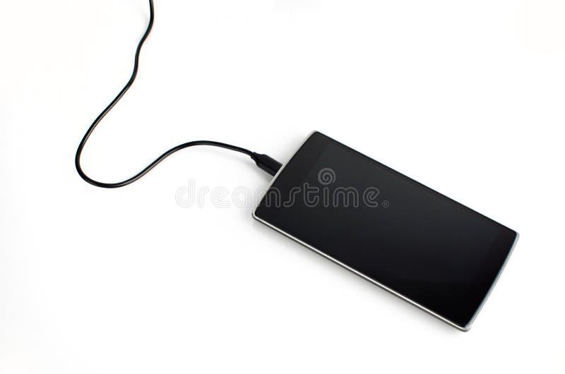 Teléfono elegante con el cable tapado fotografía de archivo